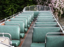 Green open top bus for weddings in Brighton